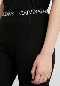 Calvin Klein Jeans - LOGO MILANO - Leggings - black - 4
