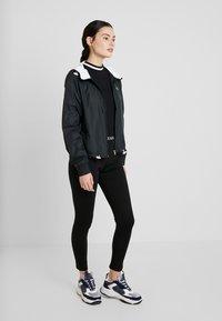 Calvin Klein Jeans - LOGO MILANO - Leggings - black - 1