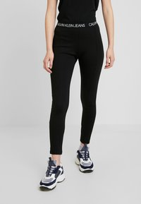 Calvin Klein Jeans - LOGO MILANO - Leggings - black - 0