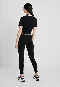 Calvin Klein Jeans - LOGO MILANO - Leggings - black - 2