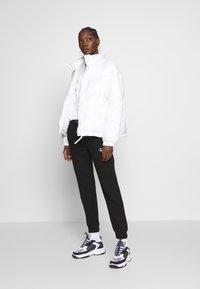 Calvin Klein Jeans - EMBROIDERY JOGGING PANTS - Joggebukse - black - 1