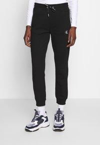 Calvin Klein Jeans - EMBROIDERY JOGGING PANTS - Joggebukse - black - 0