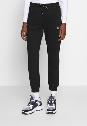 EMBROIDERY JOGGING PANTS - Tracksuit bottoms - black