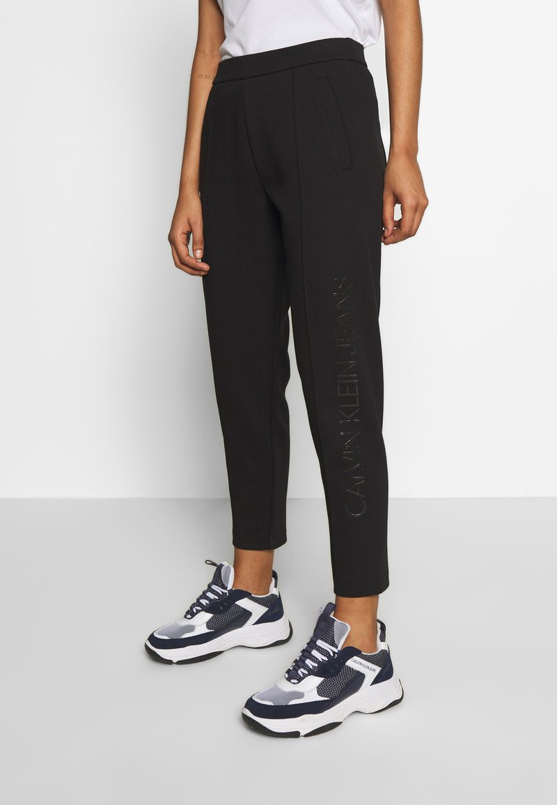 Calvin Klein Jeans - INSTITUTIONAL PANT - Tracksuit bottoms - ck black