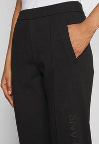 Calvin Klein Jeans - INSTITUTIONAL PANT - Tracksuit bottoms - ck black - 3