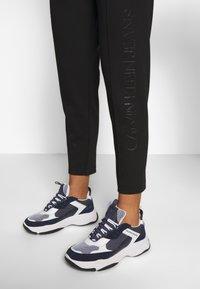 Calvin Klein Jeans - INSTITUTIONAL PANT - Tracksuit bottoms - ck black - 4