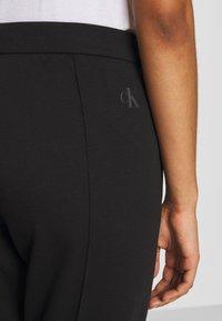 Calvin Klein Jeans - INSTITUTIONAL PANT - Joggebukse - ck black - 6
