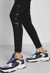 Calvin Klein Jeans - INSTITUTIONAL LOGO - Leggings - black - 4