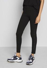 Calvin Klein Jeans - INSTITUTIONAL LOGO - Leggings - black - 0
