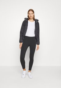 Calvin Klein Jeans - TAPE LOGO - Leggings - black - 1