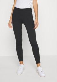 Calvin Klein Jeans - TAPE LOGO - Leggings - black - 0
