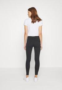 Calvin Klein Jeans - TAPE LOGO - Leggings - black - 2