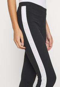 Calvin Klein Jeans - TAPE LOGO - Leggings - black - 4