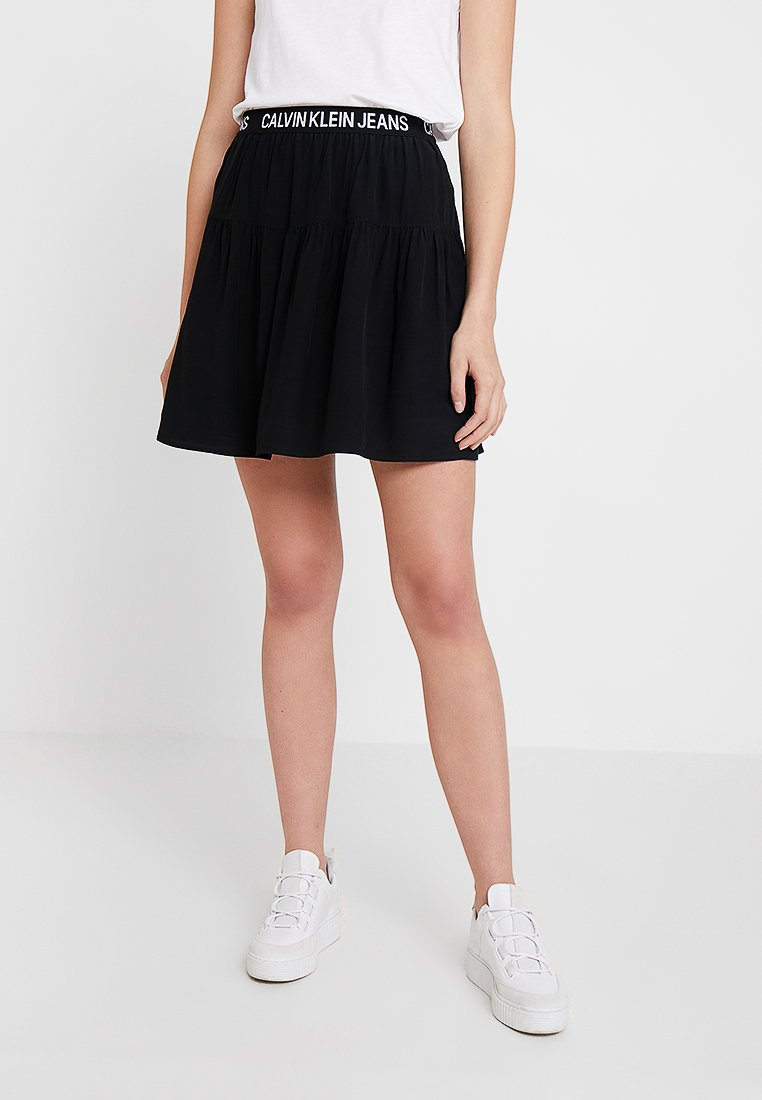 Calvin Klein Jeans - FLORAL LOGO TAPE SKIRT - A-line skirt - black