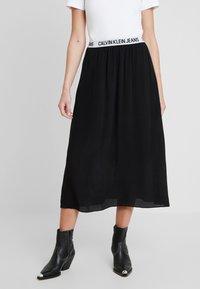 Calvin Klein Jeans - LOGO ELASTIC MIDI SKIRT - Maxi sukně - black - 0