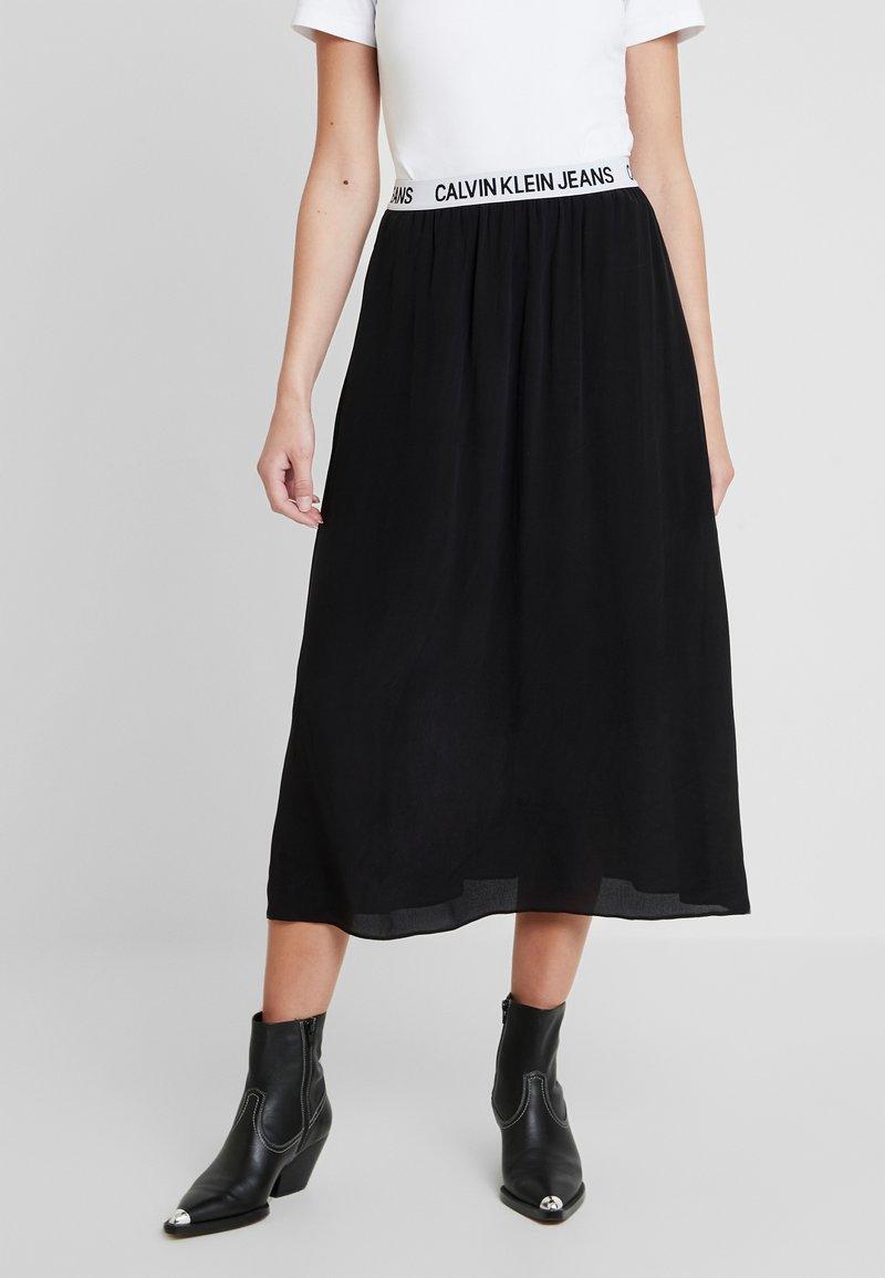 Calvin Klein Jeans - LOGO ELASTIC MIDI SKIRT - Maxi sukně - black