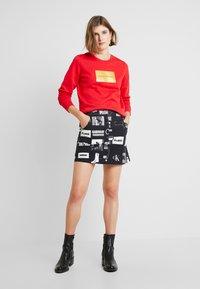 Calvin Klein Jeans - PUNK SKIRT - Jeanskjol - black - 1