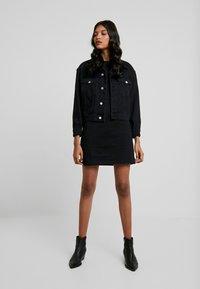 Calvin Klein Jeans - MONOGRAM TAPE DRESS - Day dress - black - 1