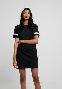 Calvin Klein Jeans - MONOGRAM TAPE DRESS - Day dress - black - 0