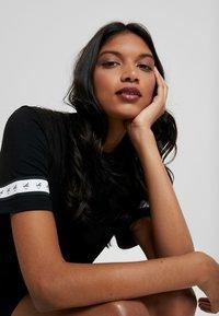 Calvin Klein Jeans - MONOGRAM TAPE DRESS - Day dress - black - 3