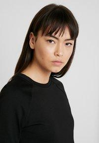 Calvin Klein Jeans - MID SLEEVE MILANO LOGO ELASTIC - Denní šaty - black - 4