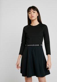Calvin Klein Jeans - MID SLEEVE MILANO LOGO ELASTIC - Denní šaty - black - 0