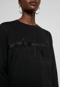 Calvin Klein Jeans - TAPING THROUGH MONOGRAM DRESS - Vestido informal - black - 6