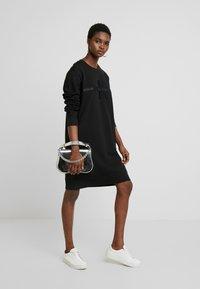 Calvin Klein Jeans - TAPING THROUGH MONOGRAM DRESS - Vestido informal - black - 2