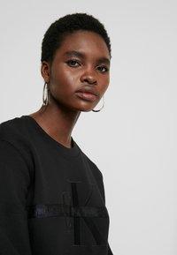 Calvin Klein Jeans - TAPING THROUGH MONOGRAM DRESS - Vestido informal - black - 4