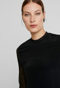 Calvin Klein Jeans - SKATER DRESS - Denní šaty - black - 5