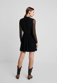 Calvin Klein Jeans - SKATER DRESS - Denní šaty - black - 3
