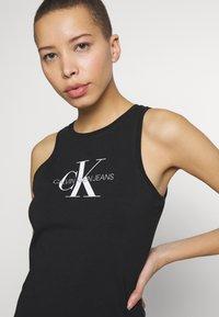 Calvin Klein Jeans - MONOGRAM TANK DRESS - Žerzejové šaty - black - 3