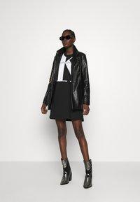 Calvin Klein Jeans - LARGE OVERSIZED DRESS - Jersey dress - black - 1