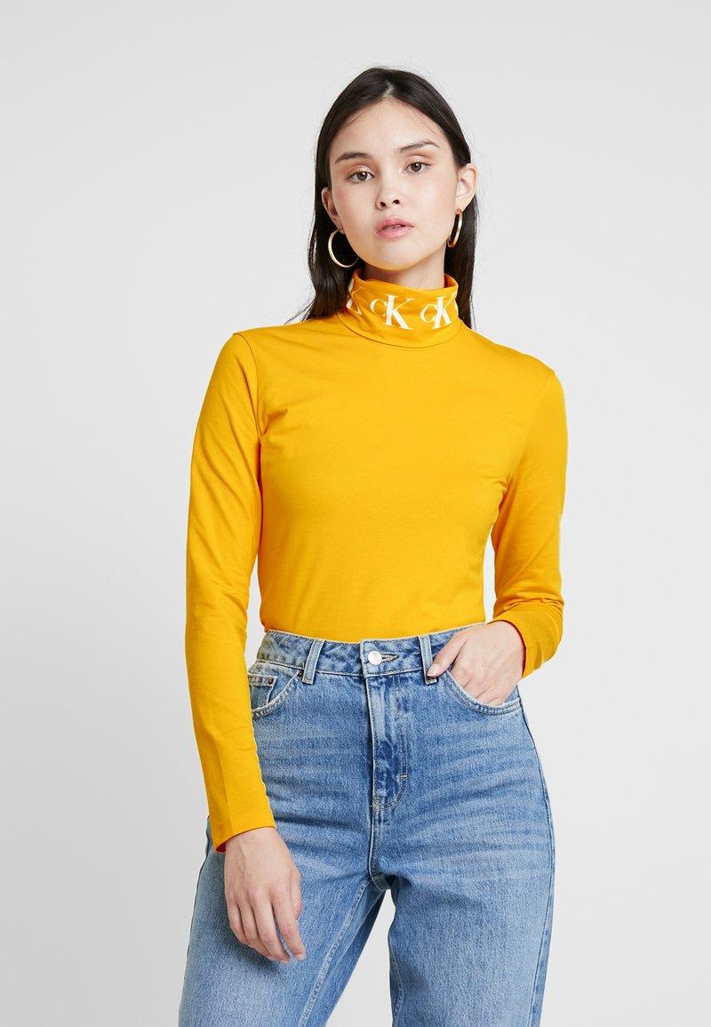 Calvin Klein Jeans - MONOGRAM TAPE ROLL NECK - Long sleeved top - lemon chrome/bright white