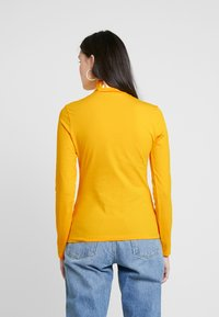Calvin Klein Jeans - MONOGRAM TAPE ROLL NECK - Long sleeved top - lemon chrome/bright white - 2