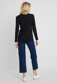Calvin Klein Jeans - MONOGRAM TAPE STRAIGHT TEE - T-shirt à manches longues - black - 2