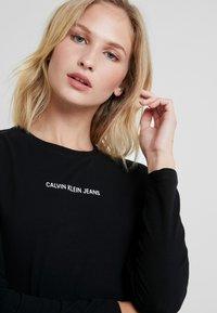 Calvin Klein Jeans - LOGO STRETCH SLIM - Long sleeved top - black - 3