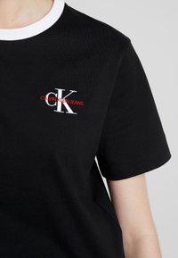 Calvin Klein Jeans - MONOGRAM EMBROIDERY RINGER TEE - T-shirts print - black - 4
