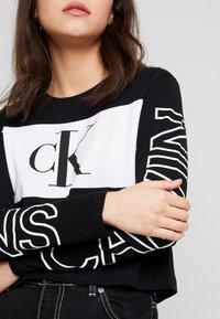 Calvin Klein Jeans - BLOCKING STATEMENT LOGO TEE - Long sleeved top - black - 5