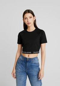 Calvin Klein Jeans - LOGO MILANO - T-shirt print - black - 0