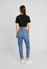 Calvin Klein Jeans - LOGO MILANO - T-shirt print - black - 2
