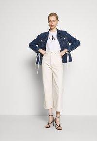 Calvin Klein Jeans - MONOGRAM STRETCH SPORTY TANK - Top - bright white - 1