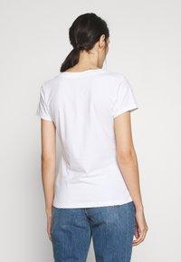 Calvin Klein Jeans - EMBROIDERY V NECK - Basic T-shirt - bright white - 2