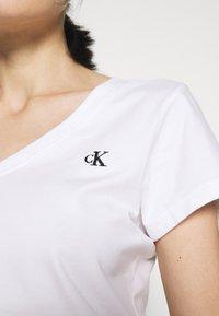 Calvin Klein Jeans - EMBROIDERY V NECK - Basic T-shirt - bright white - 4