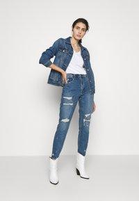 Calvin Klein Jeans - EMBROIDERY V NECK - Basic T-shirt - bright white - 1
