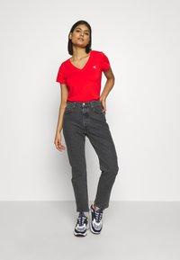 Calvin Klein Jeans - EMBROIDERY V NECK - Jednoduché triko - fiery red - 1