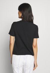 Calvin Klein Jeans - ROUND LOGO STRAIGHT TEE - T-shirt print - black - 2