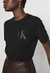 Calvin Klein Jeans - BACK INSTITUTIONAL LOGO SLIM TEE - Print T-shirt -  black - 5