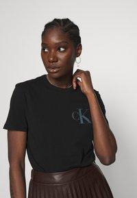 Calvin Klein Jeans - BACK INSTITUTIONAL LOGO SLIM TEE - Print T-shirt -  black - 3