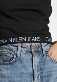 Calvin Klein Jeans - LOGO ELASTIC MILANO HALF ZIP - Print T-shirt - black - 5